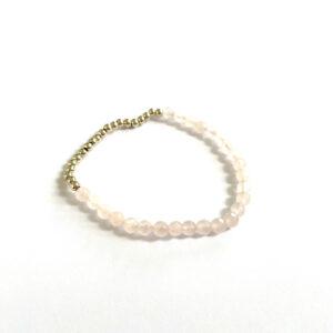 Armband met rozenkwarts kralen goud