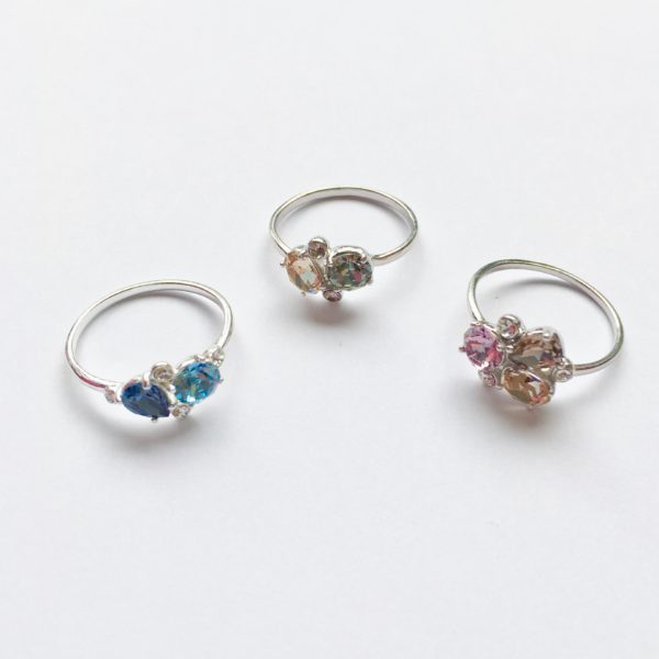 Zilveren ring met zirkonia beige groen grijs roze blauw